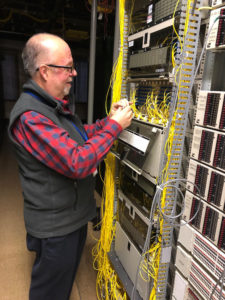 Dan Siracuse helps test fiber connections.